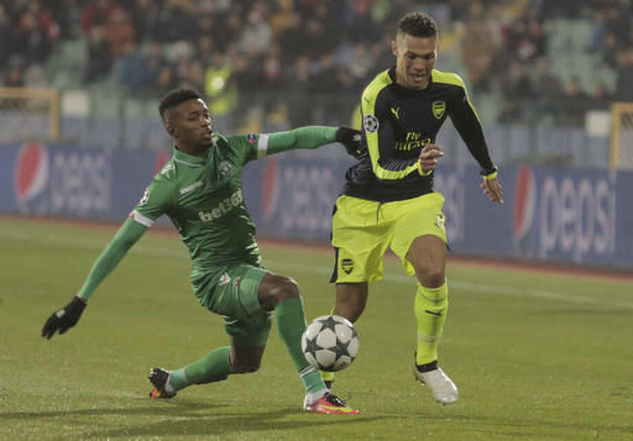 Arsenal's Kieran Gibbs, right, fights for the ball with Ludogorets' Jonathan Cafu during the Champions League group A soccer match between Ludogorets and Paris Saint-Germain, at Vassil Levski stadium in Sofia, Bulgaria, Tuesday, Nov. 1, 2016. (AP Photo/Valentina Petrova)