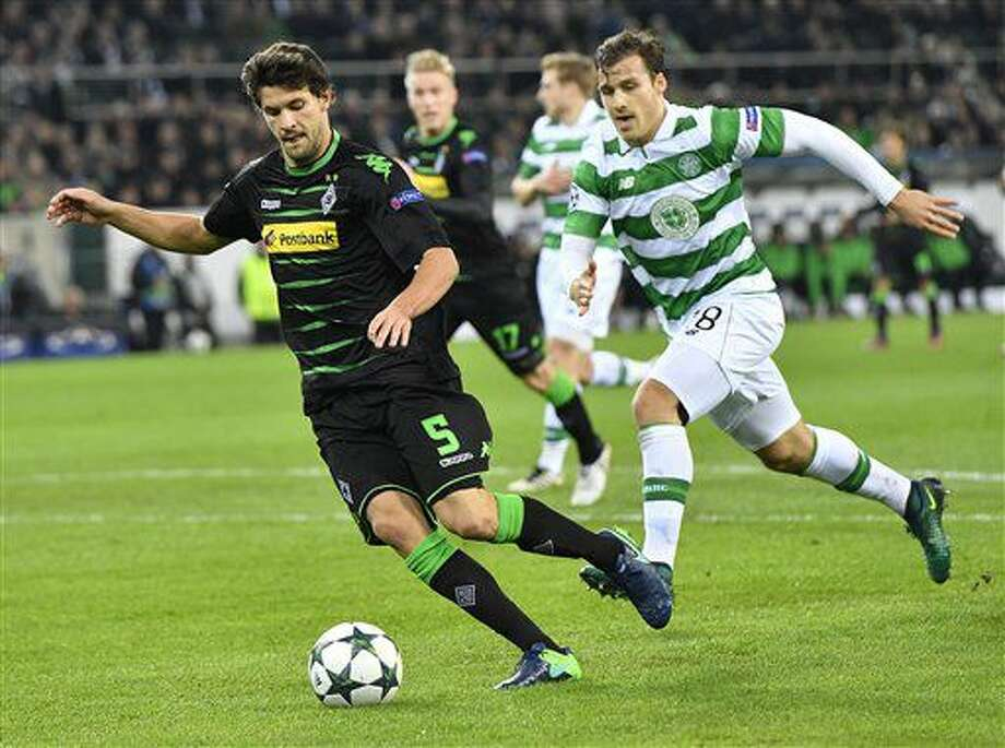 Moenchengladbach's Tobias Strobl, left, and Celtic's Erik Sviatchenko challenge for the ball during the Champions League group C soccer match between Borussia Moenchengladbach and Celtic FC in Moenchengladbach, Germany, Tuesday, Nov. 1, 2016. (AP Photo/Martin Meissner)