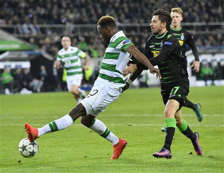 Moenchengladbach's Julian Korb, right, fouls Celtic's Mousaa Dembele for a penalty during the Champions League group C soccer match between Borussia Moenchengladbach and Celtic FC in Moenchengladbach, Germany, Tuesday, Nov. 1, 2016. (AP Photo/Martin Meissner)