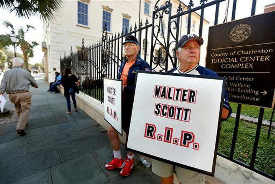 John Barker and Arthur Kunisch at the courthouse to show support for Walter Scott and his family as jury selection begins in the trial of former police officer Michael Slager Monday, Oct. 31, 2016, in Charleston, S.C. The two men traveled from New Jersey to show their support for Scott and his family. (Grace Beahm/The Post and Courier via AP)