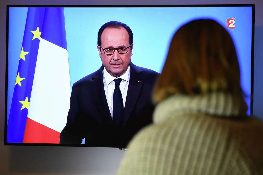 A person watches on December 1, 2016 a TV screen showing French President Francois Hollande announcing his renouncement to run for the next French presidential elections. Francois Hollande dramatically announced he would not seek re-election next year as he bowed to historic low approval ratings after a troubled five years in power. The withdrawal means the 62-year-old Socialist leader is the first president of France's fifth republic, founded in 1958, to step aside after only one term.  / AFP PHOTO / DAMIEN MEYERDAMIEN MEYER/AFP/Getty Images Photo: DAMIEN MEYER, Staff / AFP or licensors