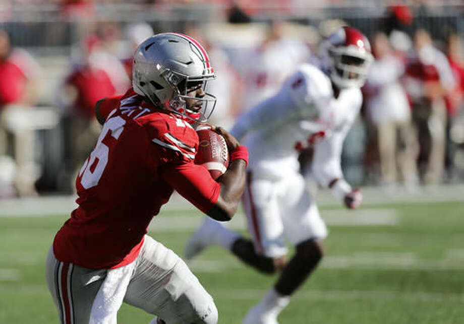 Ohio State quarterback J.T. Barrett runs the ball against Indiana during the first half of an NCAA college football game Saturday, Oct. 8, 2016, in Columbus, Ohio. Ohio State beat Indiana 38-17. (AP Photo/Jay LaPrete)