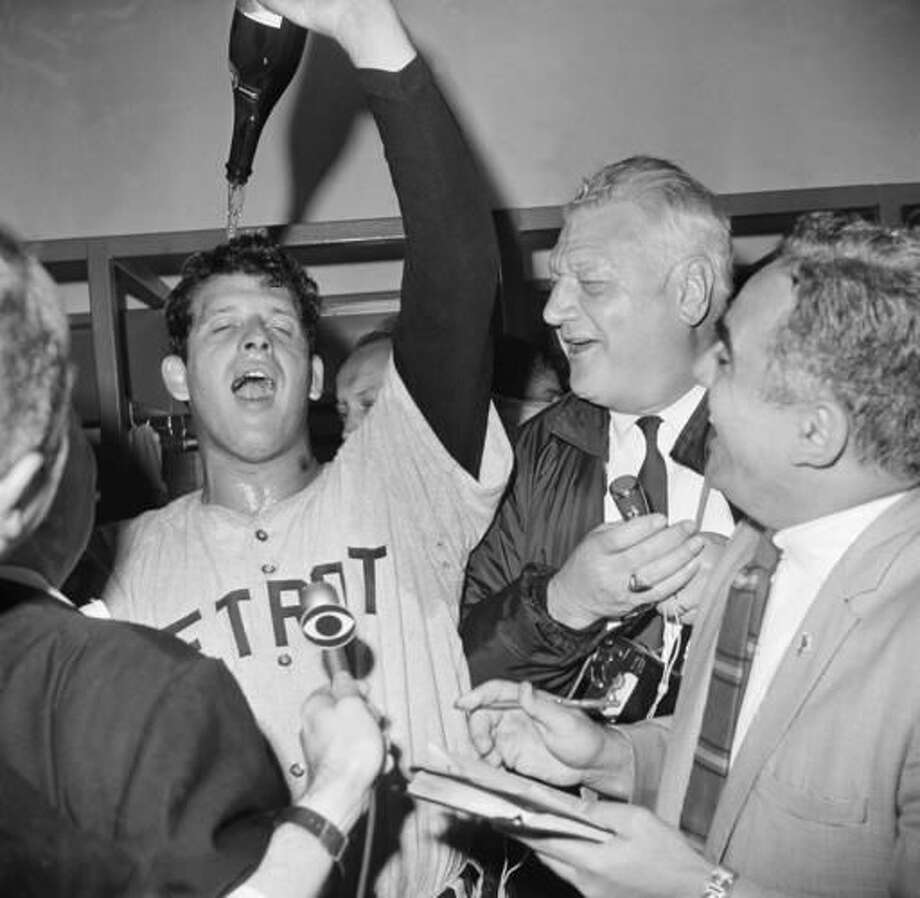 FILE- In this Oct. 10, 1968, file photo, Detroit Tigers Pitcher Mickey Lolich he pours bottle of champagne on his head in clubhouse after defeating the St. Louis Cardinals 4-1 in Game 7 of baseball's World Series in 1968. Lolich pitched a five-hitter, throwing shutout ball into the ninth inning to beat Bob Gibson and the Cardinals. Just nine pitchers have won three starts in a single series, none since Lolich went 3-0 with a 1.67 ERA and 21 strikeouts while pitching three complete games in 1968. (AP Photo/File)