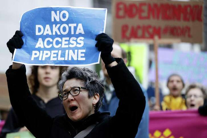 Protesters demonstrate in solidarity with members of the Standing Rock Sioux tribe in North Dakota over the construction of the Dakota Access oil pipeline in Philadelphia, Thursday, Dec. 1, 2016. (AP Photo/Matt Rourke)