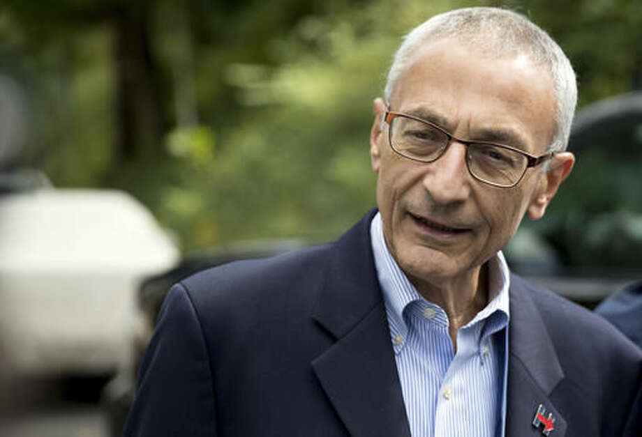 In this Oct. 5, 2016, photo, Hillary Clinton campaign chairman John Podesta speaks to members of the media outside Clinton's home in Washington. The WikiLeaks organization on Oct. 7, posted what it said were thousands of emails from Podesta, including some with excerpts from speeches she gave to Wall Street executives and others — speeches she has declined to release despite demands from Trump. (AP Photo/Andrew Harnik)