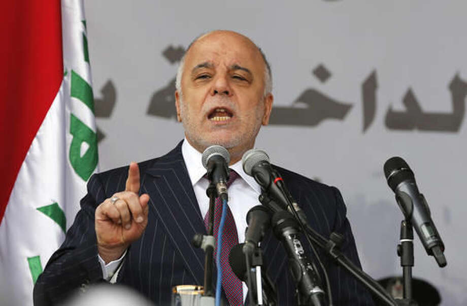 FILE - In this Jan. 9, 2016, file photo, Iraq's Prime Minister Haider al-Abadi, speaks during a ceremony marking Police Day at the police academy in Baghdad, Iraq. Iraq's supreme court struck down key reforms proposed by Prime Minister Haider al-Abadi on Monday, Oct. 10, 2016, marking another setback for the increasingly isolated leader as he seeks to unite the country ahead of a march on the Islamic State-held city of Mosul. The premier had proposed abolishing the two vice presidential and deputy prime minister posts, largely ceremonial positions created after the 2003 U.S.-led invasion to give the Sunni and Kurdish minorities a greater presence in the Shiite-led government. (AP Photo/Karim Kadim, File)