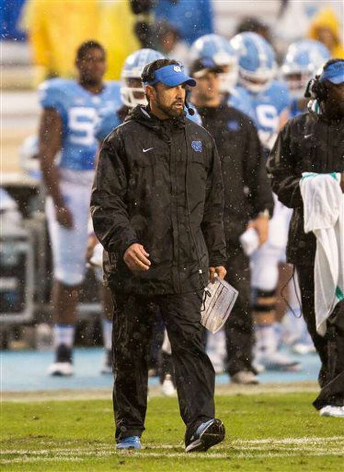 North Carolina head coach Larry Fedora walks onto the field during a timeout against Virginia Tech in the second half of an NCAA college football game in Chapel Hill, N.C., Saturday, Oct. 8, 2016. (AP Photo/Ben McKeown)