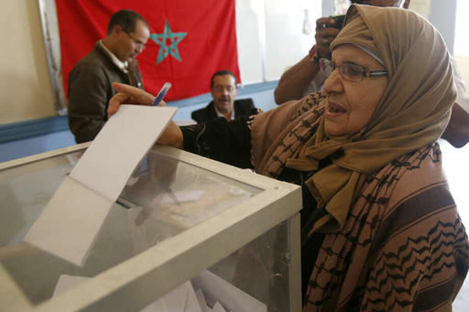 A Moroccan woman casts her ballot at a polling station for the parliamentary elections, in Rabat, Morocco, Friday, Oct. 7, 2016. Amid worries about jobs and extremism, millions of Moroccans voted Friday in parliamentary elections that will determine whether moderate Islamists will keep control of the government or lose power to a young rival party close to the powerful royal palace.(AP Photo/Abdeljalil Bounhar)