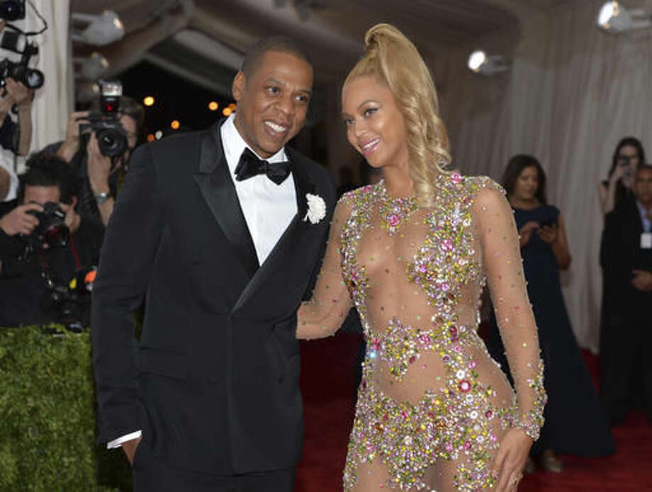 "File - In this May 4, 2015, file photo, Jay Z, left, and Beyonce arrive at The Metropolitan Museum of Art's Costume Institute benefit gala celebrating ""China: Through the Looking Glass"" in New York. The couple dressed as Barbie and Ken for Halloween in photos posted on Instagram Nov. 1, 2016. (Photo by Evan Agostini/Invision/AP, File)"
