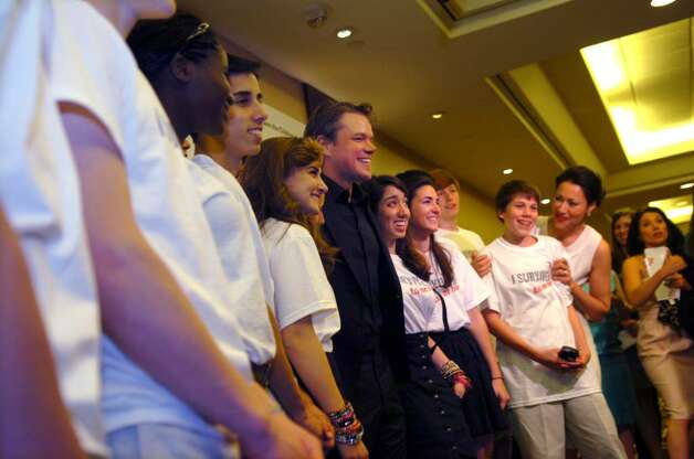 Matt Damon, center, with the children of Save the Children, and Anne Curry, NBC's Today Show and Dateline anchor, right, at the Save the Children's Celebration of Hope benefit at Hyatt Regency Greenwich, on Thursday, May 20, 2010. Photo: Helen Neafsey / Greenwich Time