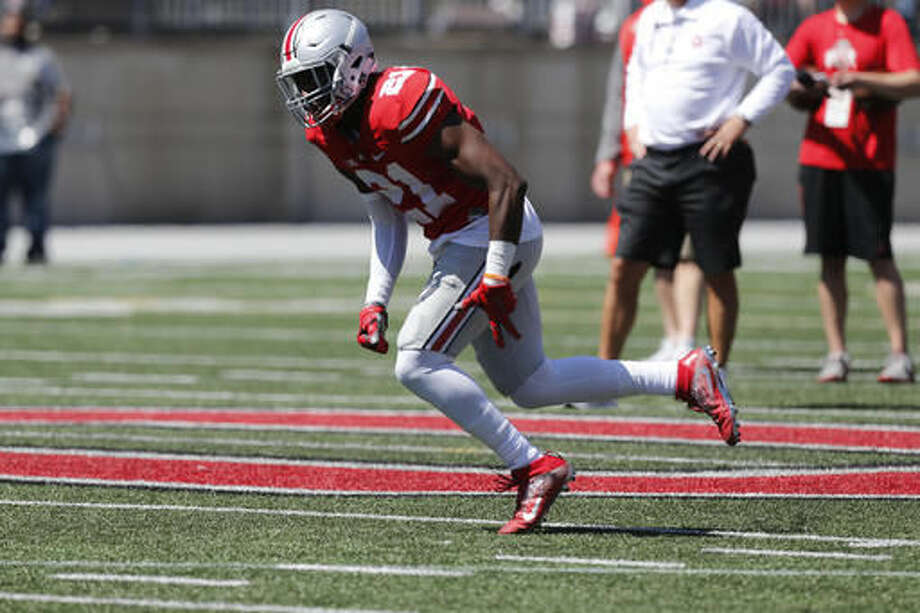 FILE - In this April 16, 2016, file photo, Ohio State wide receiver Parris Campbell plays in Ohio State's NCAA college football spring game, in Columbus, Ohio. Wide receiver Parris Campbell is getting coach Urban Meyer's attention as a special teams standout. Campbell broke a 92-yard kickoff return that turned into an Ohio State touchdown after Indiana had scored to cut the Buckeyes' lead to 17-10 with 1:03 left in the first half. (AP Photo/Jay LaPrete, File)