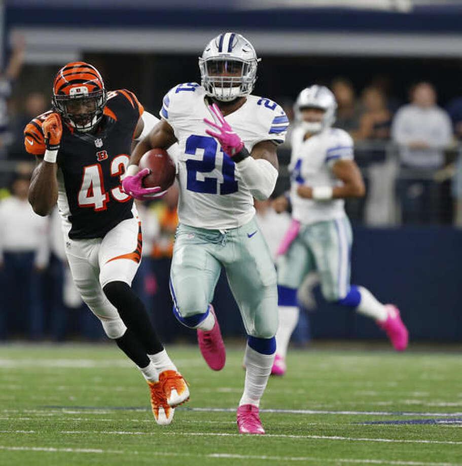Dallas Cowboys running back Ezekiel Elliott runs downfield past Cincinnati Bengals George Iloka, left, in the second half of an NFL football game, Sunday, Oct. 9, 2016, in Arlington, Texas. (Jose Yau/Waco Tribune Herald, via AP)