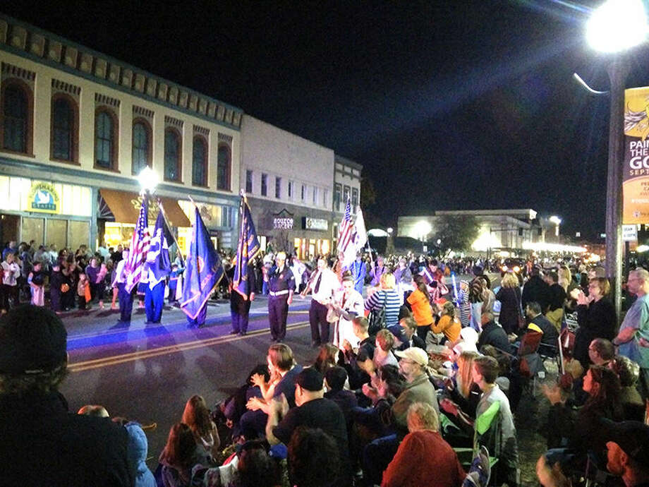 The colors pass the crowd gathered on North Main Street on Monday night.