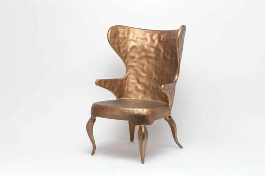 This undated photo provided by Made Goods shows the Alfred chair, The classic wingchair in hammered metal is a surprising take on the traditional form. (Made Goods via AP)