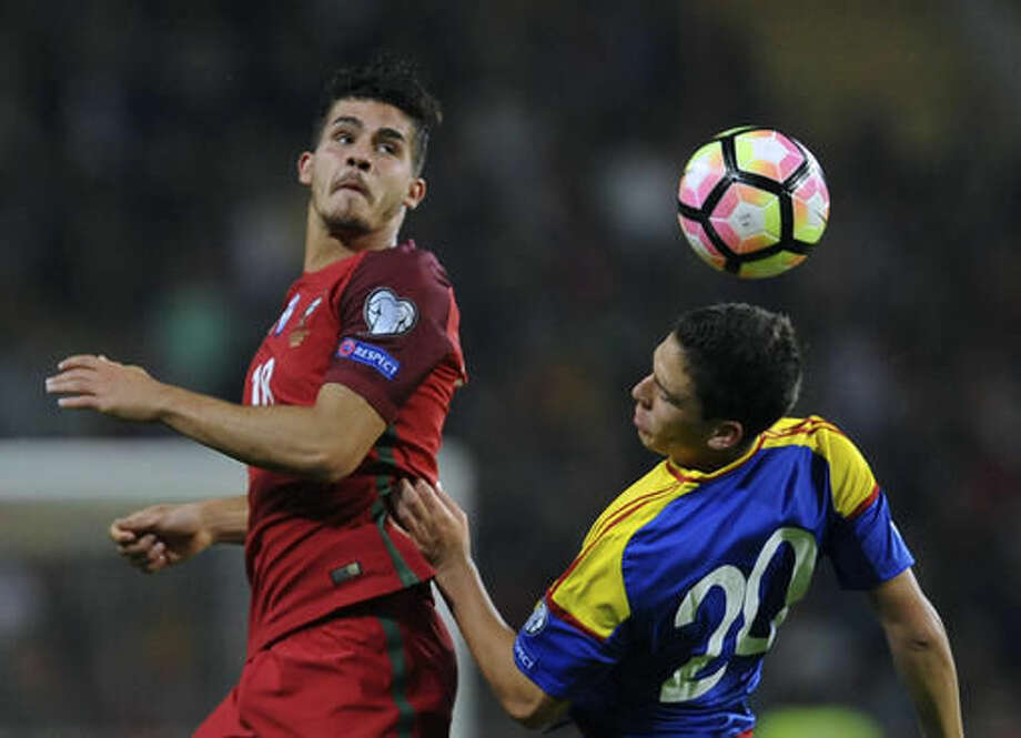 Portugal's Andre Silva, left, challenges Andorra's Max Llovera during their World Cup Group B qualifying soccer match at the Municipal Stadium in Aveiro, Portugal on Friday Oct. 7, 2016. Silva scored once in Portugal's 6-0 victory.(AP Photo/Paulo Duarte)