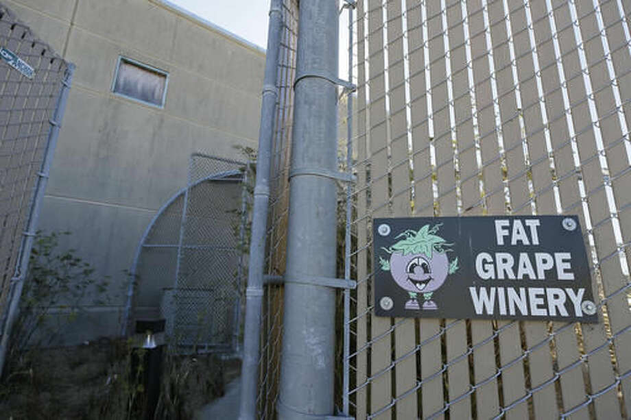 In this photo taken Saturday, Oct. 8, 2016, is the entryway to the Fat Grape Winery on Treasure Island in San Francisco. The winery is located in the old Navy brig on the historic island in San Francisco Bay. Long before San Francisco was a tech capital or hippie haven, it was a military town, and some of the region's wineries are located in the footprints of what were once military bases. (AP Photo/Eric Risberg)