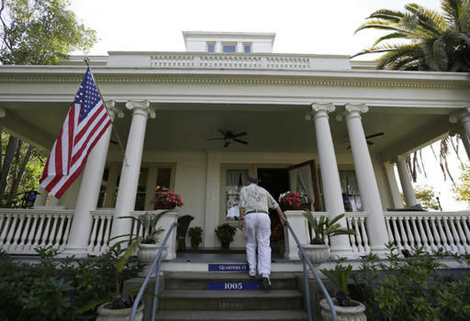 In this photo taken Friday, Oct. 7, 2016, a man makes his way up steps to the Vino Godfather winery on Mare Island in Vallejo, Calif. The winery is located in a mansion on officer's row. Mare Island was the site of the first Naval Yard on the Pacific Coast. Long before San Francisco was a tech capital or hippie haven, it was a military town, and some of the region's wineries are located in the footprints of what were once military bases.(AP Photo/Eric Risberg)