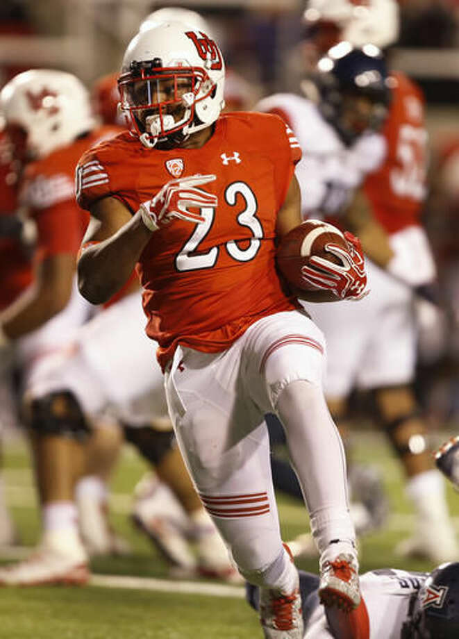 Utah running back Armand Shyne carries during the second half of an NCAA college football game against Arizona, Saturday, Oct. 8, 2016, in Salt Lake City. Utah defeated Arizona 36-23. (AP Photo/George Frey)