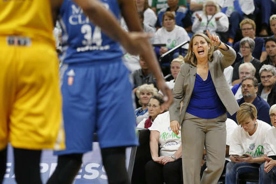 Minnesota Lynx head coach Cheryl Reeve calls out to her team in the second half of Game 1 of the WNBA basketball finals against the Lost Angeles Sparks, Sunday, Oct. 9, 2016, in Minneapolis. Los Angeles won 78-76. (AP Photo/Stacy Bengs)