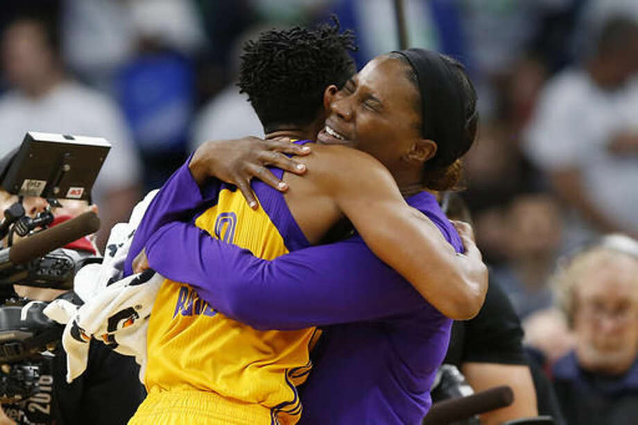 Los Angeles Sparks center Jantel Lavender hugs guard Alana Beard (0) after Beard hit the game winning shot in Game 1 of the WNBA basketball finals against the Minnesota Lynx, Sunday, Oct. 9, 2016, in Minneapolis. Los Angeles won 78-76. (AP Photo/Stacy Bengs)