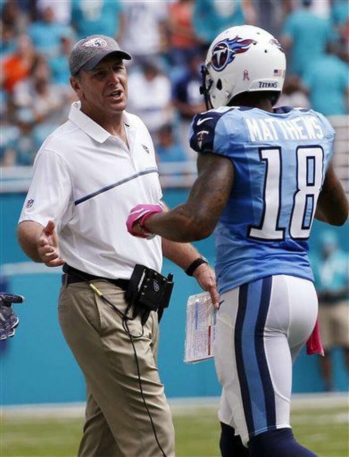 Tennessee Titans head coach Mike Mularkey talks to Tennessee Titans wide receiver Rishard Matthews (18), during the first half of an NFL football game, Sunday, Oct. 9, 2016, in Miami Gardens, Fla. The Titans defeated the Dolphins 30-17. (AP Photo/Joel Auerbach)