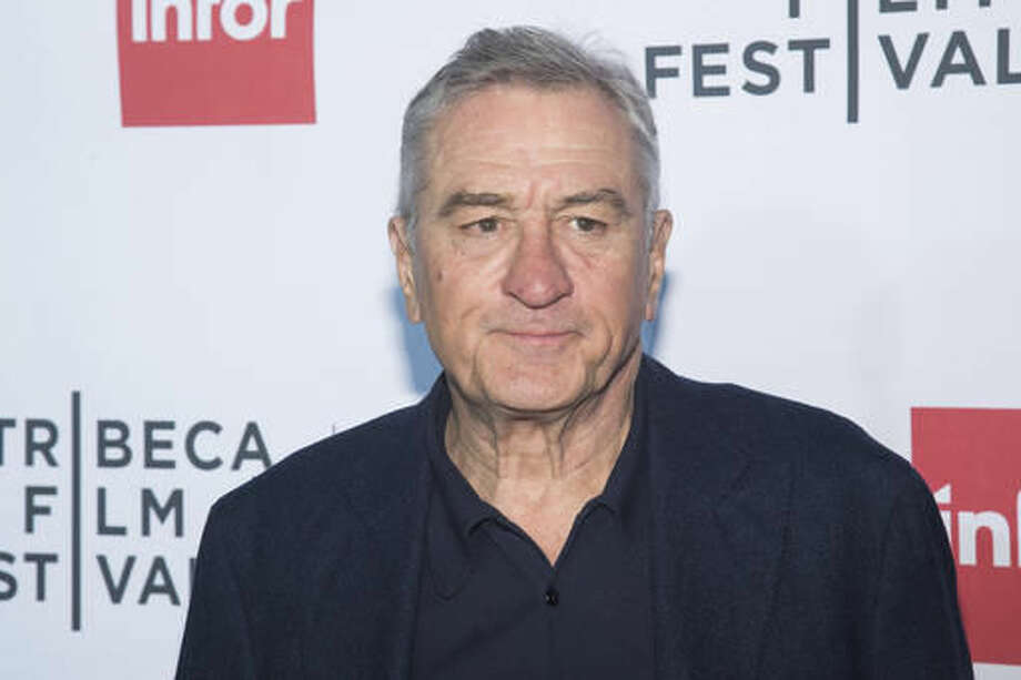 "FILE - In this April 21, 2016 file photo, Robert De Niro attends a special 40th anniversary screening of ""Taxi Driver"" during the 2016 Tribeca Film Festival in New York. The 2016 election has provoked a visceral, intense response from many in the arts community, prompting songs, videos and uncommon ferocity against Trump, arguably once one of their own. De Niro called Trump ""a dog,"" ""a pig,"" ""an idiot"" and ""a mutt, who doesn't know what he's talking about."" (Photo by Charles Sykes/Invision/AP, File)"