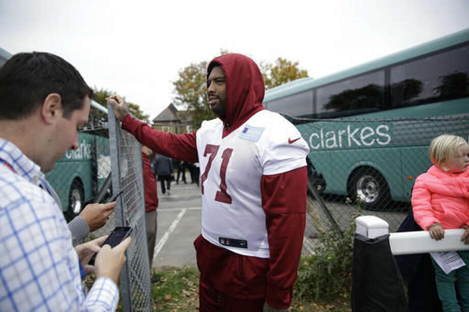Washington Redskins' offensive tackle Trent Williams, 71, who is recovering from an injury, speaks to journalists after a training session at Wasps rugby union team training ground in west London, Friday, Oct. 28, 2016. The Washington Redskins are due to play the Cincinnati Bengals at Wembley stadium in London on Sunday in a regular season NFL game. (AP Photo/Matt Dunham)