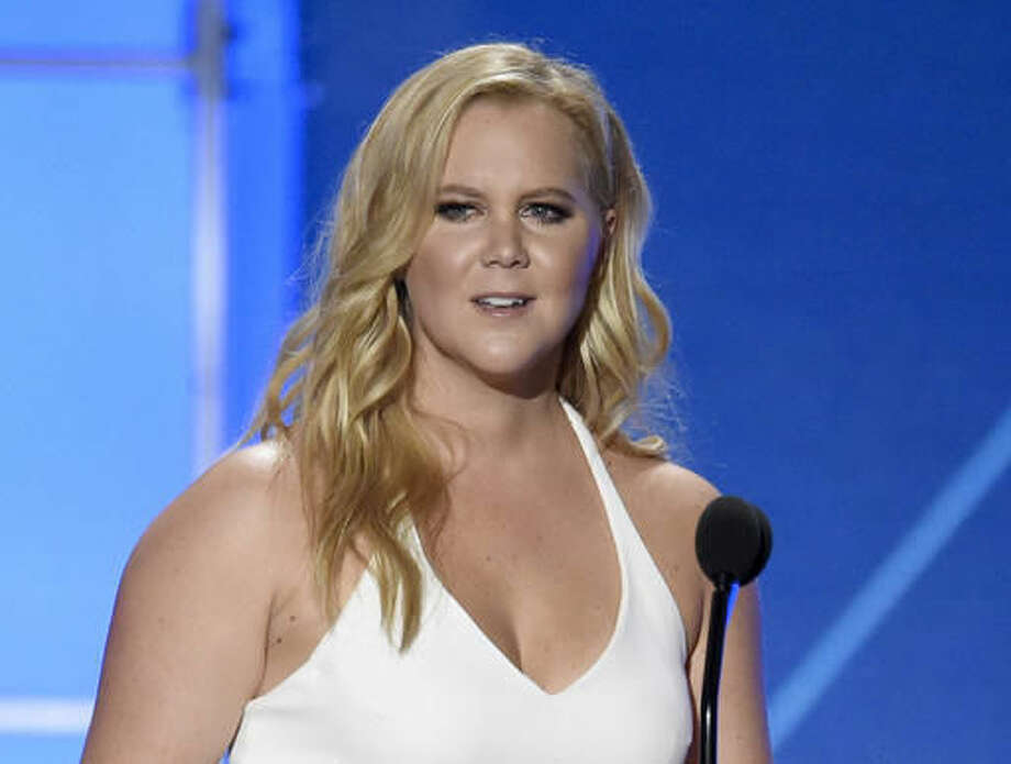 "FILE - In this Jan. 17, 2016 file photo, Amy Schumer accepts the Critics' Choice MVP award at the 21st annual Critics' Choice Awards in Santa Monica, Calif. The 2016 election has provoked a visceral, intense response from many in the arts community, prompting songs, videos and uncommon ferocity against Trump, arguably once one of their own. During one of her shows, Schumer called him an ""orange, sexual-assaulting, fake college-starting monster,"" and her diatribe caused some to walk out. (Photo by Chris Pizzello/Invision/AP, File)"
