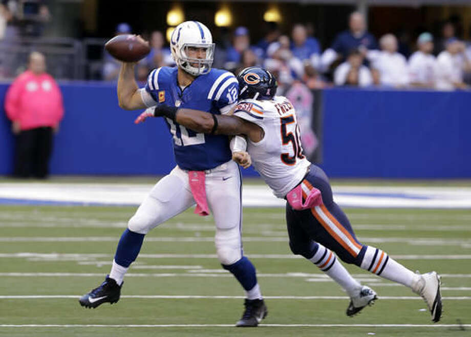 Indianapolis Colts quarterback Andrew Luck (12) is hit by Chicago Bears inside linebacker Jerrell Freeman (50) during the second half of an NFL football game in Indianapolis, Sunday, Oct. 9, 2016. (AP Photo/Darron Cummings)