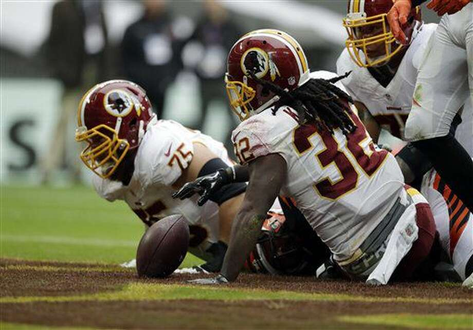 Washington Redskins running back Rob Kelley (32) scores a touchdown during an NFL Football game between Cincinnati Bengals and Washington Redskins at Wembley Stadium in London, Sunday Oct. 30, 2016. (AP Photo/Tim Ireland)