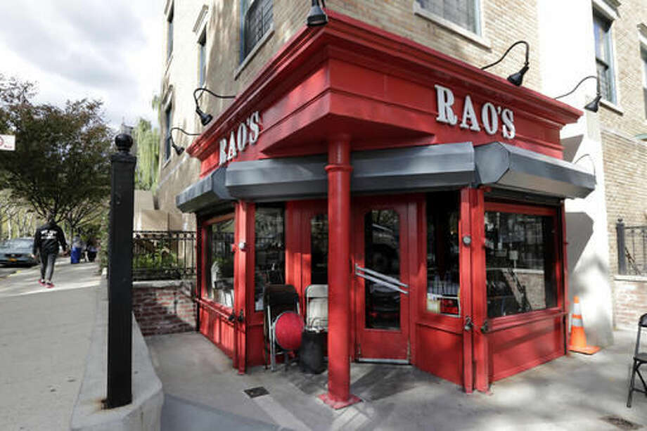 This Oct. 24, 2016 photo shows the exterior of Rao's restaurant in the Harlem section of New York. The restaurant has been around for 120 years and is one of the hardest-to-get tables in the country, let alone the city. (AP Photo/Richard Drew)