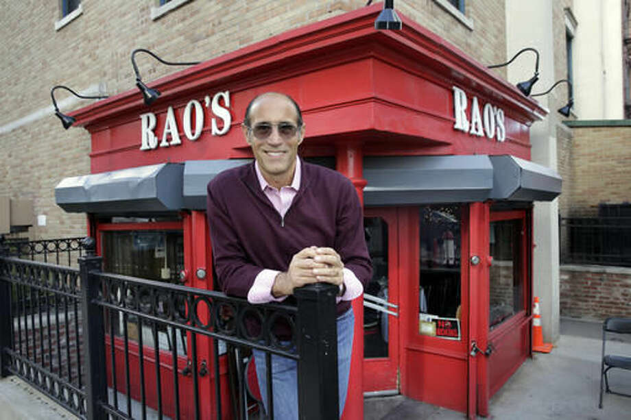 In this Oct. 24, 2016 photo, Frank Pellegrino Jr., owner of Rao's, poses outside restaurant in the Harlem neighborhood of New York. The restaurant has been around for 120 years and is one of the hardest-to-get tables in the country, let alone the city. (AP Photo/Richard Drew)