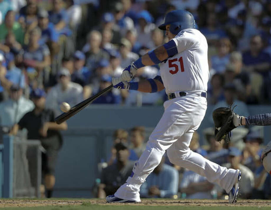 Los Angeles Dodgers' Carlos Ruiz hits a two-run home run during the fifth inning in Game 3 of baseball's National League Division Series against the Washington Nationals in Los Angeles, Monday, Oct. 10, 2016. (AP Photo/Jae C. Hong)