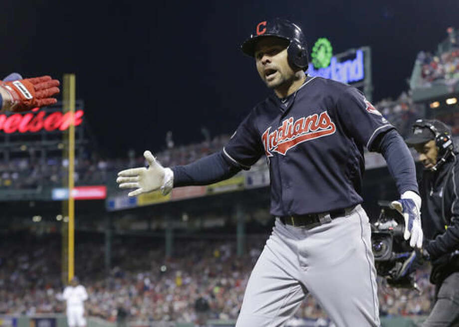 Cleveland Indians' Coco Crisp celebrates his two-run home run against the Boston Red Sox during the sixth inning in Game 3 of baseball's American League Division Series, Monday, Oct. 10, 2016, in Boston. (AP Photo/Elise Amendola)