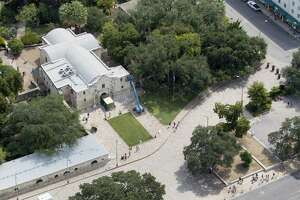 Alamo Plaza, with the Alamo at the top of the frame, is seen in a Thursday Oct. 8, 2015 aerial photo. Three buildings the Texas General Land Office recently agreed to buy can be seen at the bottom of the frame.