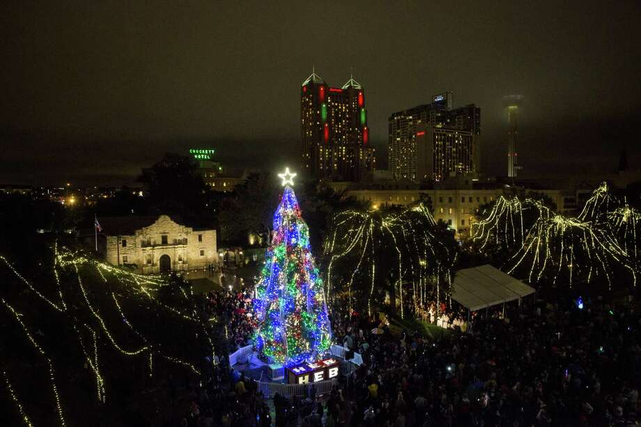 Seeing the towering Christmas tree back in Alamo Plaza San Antonians who incorporated the annual tree-lighting ceremony in front of the Alamo into their own traditions for generations were upset to find out the event had been moved to Travis Park this year. While some lamented on social media, others set up tiny trees around the walkways near the Alamo in an attempt to restore the 33-year-old tradition.  Photo: Carolyn Van Houten, Staff / San Antonio Express-News / 2015 San Antonio Express-News
