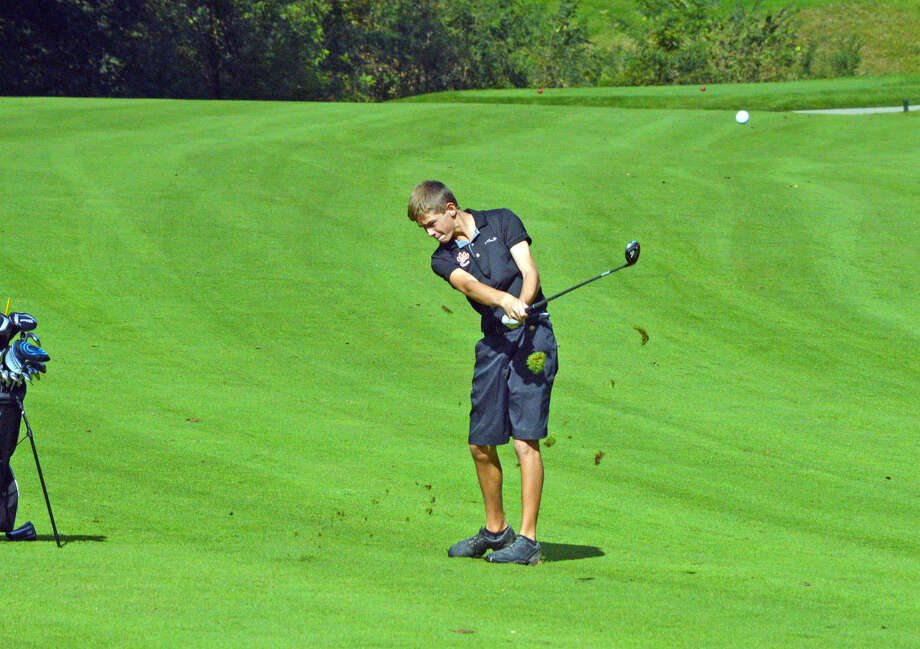 Edwardsville sophomore Blake Burris hits his third shot on hole No. 6 at Lick Creek Golf Course on Monday during the Class 3A Pekin Sectional.
