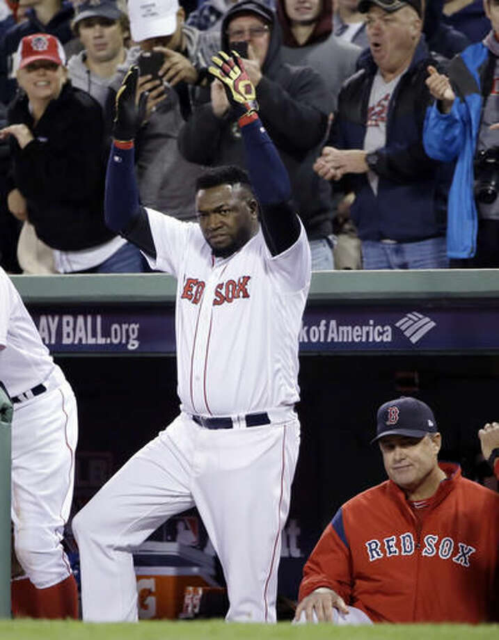 Boston Red Sox designated hitter David Ortiz encourages the crowd beside manager John Farrell in the dugout during the eighth inning in Game 3 of baseball's American League Division Series against the Cleveland Indians, Monday, Oct. 10, 2016, in Boston. (AP Photo/Elise Amendola)
