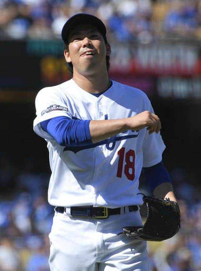 Los Angeles Dodgers starting pitcher Kenta Maeda, of Japan, reacts after giving up a hit to Washington Nationals' Jayson Werth during the first inning in Game 3 of baseball's National League Division Series in Los Angeles, Monday, Oct. 10, 2016. (AP Photo/Mark J. Terrill)