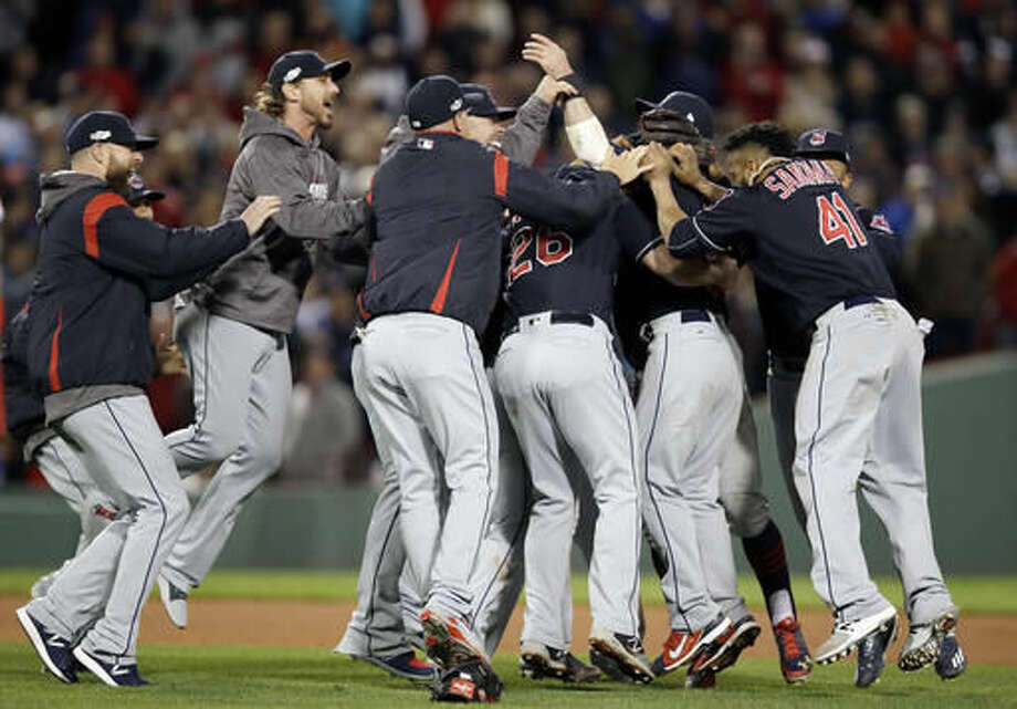 The Cleveland Indians celebrate their 4-3 win over the Boston Red Sox in Game 3 of baseball's American League Division Series, Monday, Oct. 10, 2016, in Boston. (AP Photo/Charles Krupa)