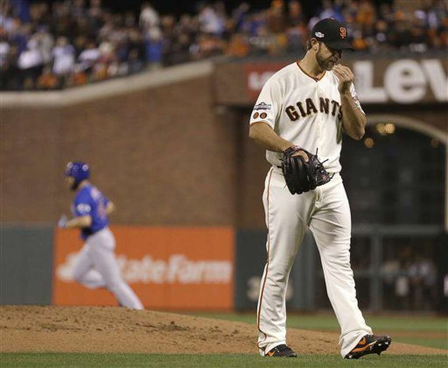 Chicago Cubs' Jake Arrieta, rear, rounds the bases after hitting a three-run home run off of San Francisco Giants pitcher Madison Bumgarner, right, during the second inning of Game 3 of baseball's National League Division Series in San Francisco, Monday, Oct. 10, 2016. (AP Photo/Ben Margot)