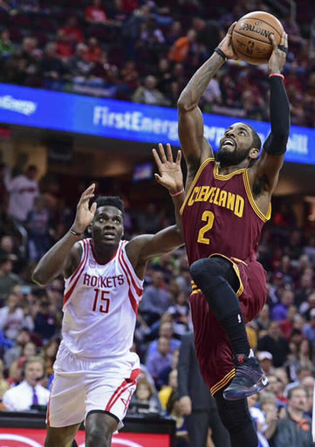 Cleveland Cavaliers guard Kyrie Irving (2) goes in for the dunk while Houston Rockets Clint Capela (15) watches in the first half of an NBA basketball game Tuesday, Nov. 1, 2016, in Cleveland. (AP Photo/David Dermer)