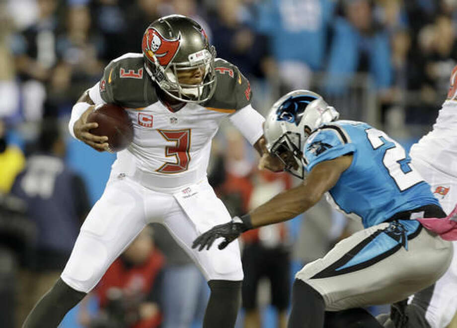 Tampa Bay Buccaneers' Jameis Winston, left, is sacked by Carolina Panthers' Robert McClain, right, in the first half of an NFL football game in Charlotte, N.C., Monday, Oct. 10, 2016. (AP Photo/Bob Leverone)