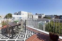 The tile deck off the back of the condo overlooks Presidio Heights.