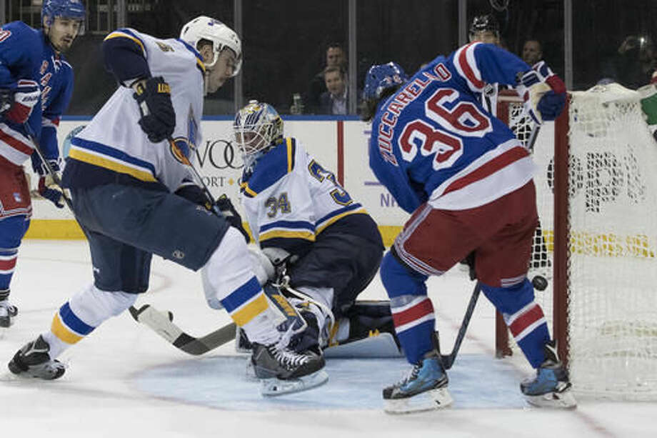 New York Rangers right wing Mats Zuccarello (36) scores a goal past St. Louis Blues goalie Jake Allen (34) and defenseman Joel Edmundson (6) during the second period of an NHL hockey game, Tuesday, Nov. 1, 2016, at Madison Square Garden in New York. (AP Photo/Mary Altaffer)