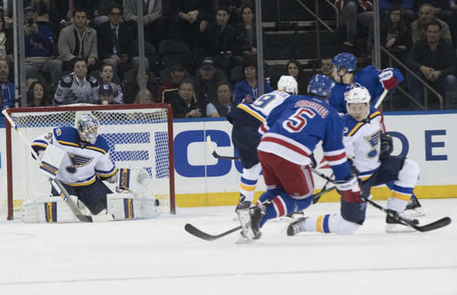New York Rangers defenseman Dan Girardi (5) scores a goal past St. Louis Blues goalie Jake Allen (34) during the first period of an NHL hockey game, Tuesday, Nov. 1, 2016, at Madison Square Garden in New York. (AP Photo/Mary Altaffer)