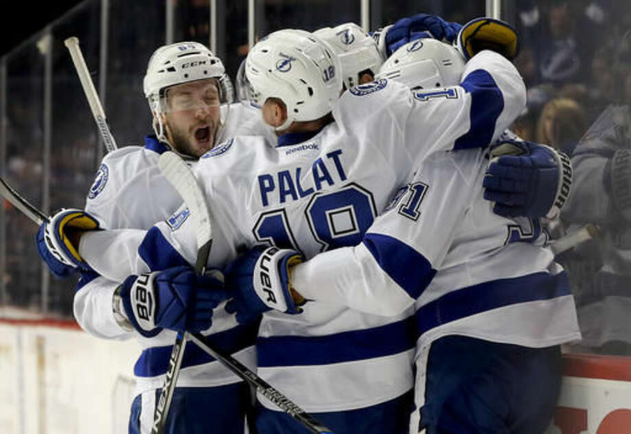 Tampa Bay Lightning right wing Nikita Kucherov, left, celebrates with teammates after the Lightning scored a goal against the New York Islanders during the first period of an NHL hockey game, Tuesday, Nov. 1, 2016, in New York. (AP Photo/Julie Jacobson)