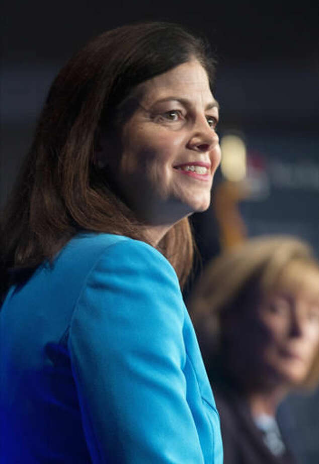 FILE - In this Monday, Oct. 3, 2016, file photo, incumbent Republican U.S. Sen. Kelly Ayotte listens to a question during a debate with Democratic challenger Gov. Maggie Hassan by New England Cable News at New England College in Henniker, N.H. Ayotte's decision to drop her support for Republican presidential nominee Donald Trump is getting a mixed response from voters, but even some who disagree with her are still backing her re-election efforts. (AP Photo/Jim Cole, File)
