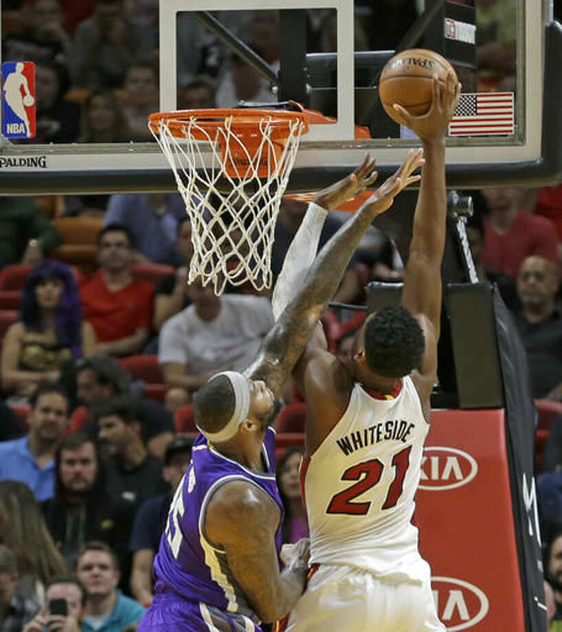 Miami Heat center Hassan Whiteside (21) goes to the basket against Sacramento Kings center DeMarcus Cousins (15) during the first half of an NBA basketball game, Tuesday, Nov. 1, 2016, in Miami. (AP Photo/Alan Diaz)