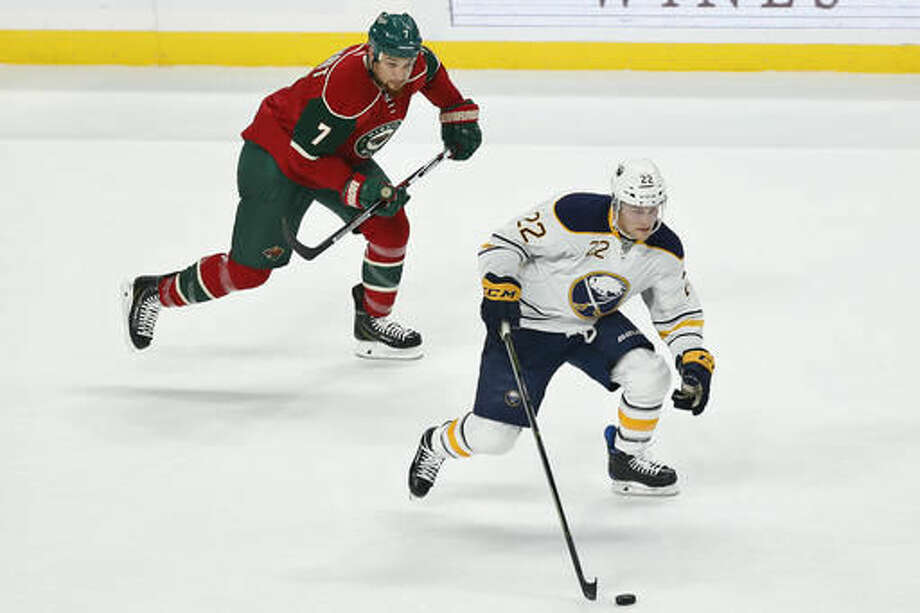 Buffalo Sabres' Johan Larsson, right, controls the puck against Minnesota Wild's Chris Stewart chases in the first period of an NHL hockey game Tuesday, Nov. 1, 2016, in St. Paul, Minn. (AP Photo/Stacy Bengs)